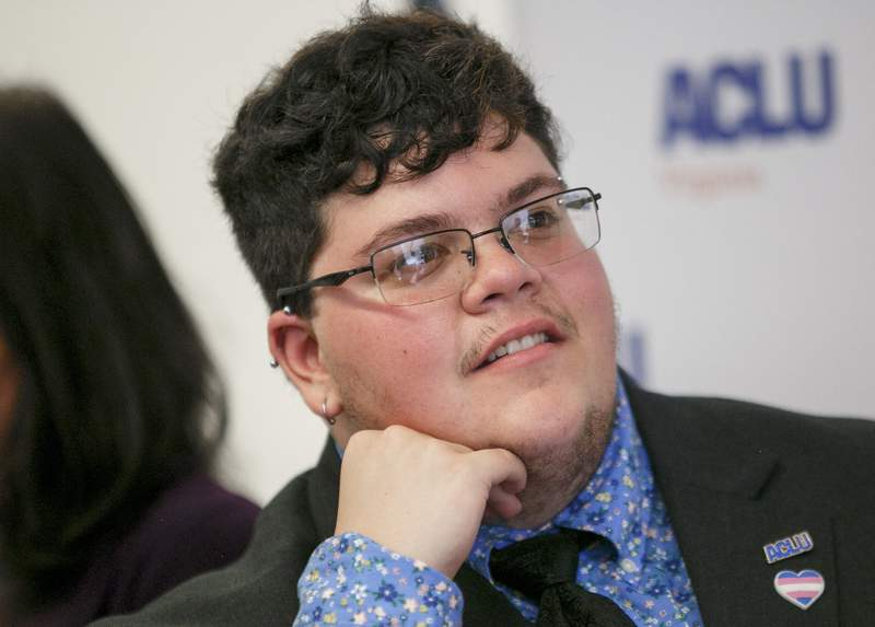FILE - In this July 23, 2019, file photo, Gavin Grimm, who has become a national face for transgender students, speaks during a news conference held by The ACLU and the ACLU of Virginia at Slover Library in Norfolk, Va. A federal appeals court is hearing arguments Tuesday, May 26, 2020, in the case of Grimm who sued a Virginia school board after he was barred as a student from using the boys bathrooms at his high school. A judge ruled last year that the Gloucester County School Board had discriminated against Grimm. (Kristen Zeis/The Daily Press via AP, File)