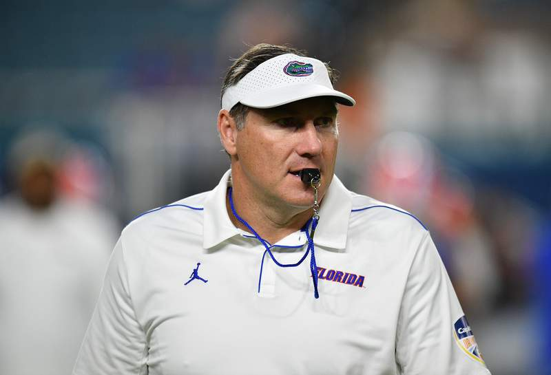 MIAMI, FLORIDA - DECEMBER 30: Head Coach Dan Mullen of the Florida Gators looks on during warms up prior to the Capital One Orange Bowl  against the Virginia Cavaliers at Hard Rock Stadium on December 30, 2019 in Miami, Florida. (Photo by Mark Brown/Getty Images)