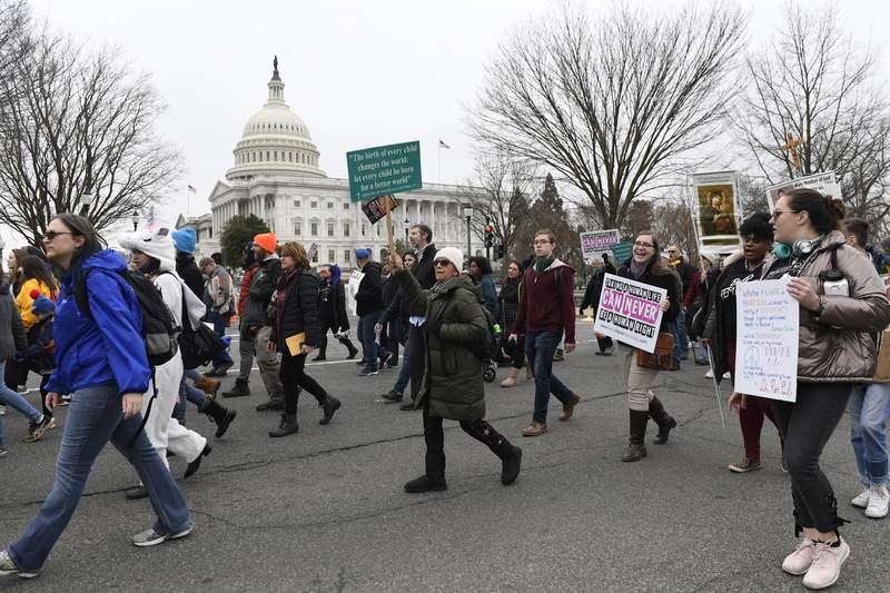 """FILE - In this Friday, Jan. 24, 2020 file photo, anti-abortion activists participate in the """"March for Life"""" rally near Capitol Hill in Washington. Organizers of the March for Life, the anti-abortion movements preeminent annual event, are asking their supporters nationwide not to gather in Washington in 2021 due to the COVID-19 pandemic and political unrest. (AP Photo/Susan Walsh)"""
