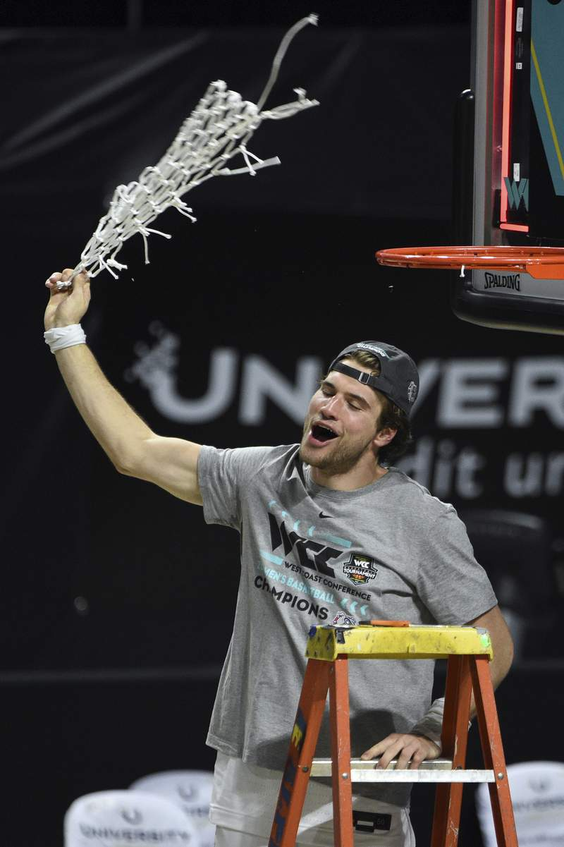 Gonzaga forward Corey Kispert swings the net after Gonzaga defeated BYU in an NCAA college basketball game for the West Coast Conference men's tournament championship Tuesday, March 9, 2021, in Las Vegas. (AP Photo/David Becker)