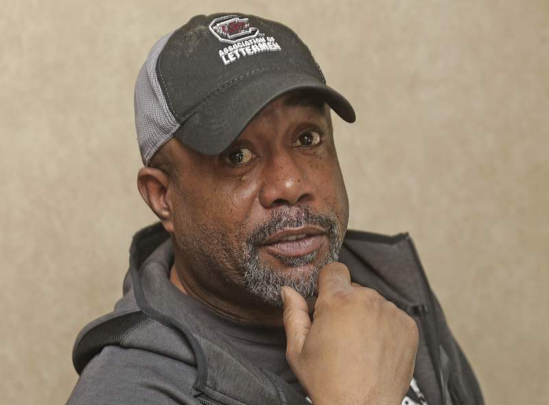 Darius Rucker poses for a photo before taking the stage. Sunday, Feb. 2, 2020 in Miami. Rucker and his band played the On Location Experiences' pregame tailgate party before Super Bowl LIV. (AP Photo/John Carucci)