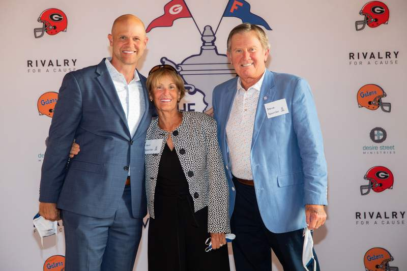 1996 Heisman Trophy winner Danny Wuerffel (left) will host the Desire Cup in Sea Island, Ga. Oct 28-29 as part of the Florida-Georgia game festivities. Also pictured are former Gators coach Steve Spurrier (right) and his wife Jerri.