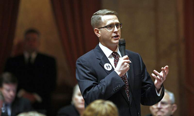 FILE - In this Feb. 8, 2012, file photo, state Rep. Matt Shea, R-Spokane Valley, speaks at the Capitol in Olympia, Wash. Shea, a right-wing lawmaker from Washington state said Friday, Jan. 10, 2020 that a recent report that branded him a domestic terrorist'' is a lie and that he will continue to represent the people of his district. (AP Photo/Elaine Thompson, File)