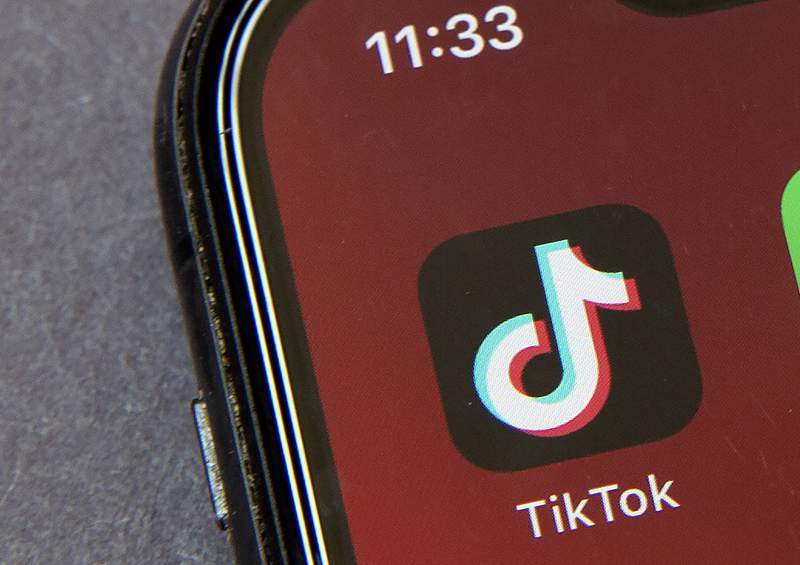 FILE - In this Friday, Aug. 7, 2020 file photo, the icons for the smartphone app TikTok on a smartphone screen in Beijing. A TikTok executive told a British parliamentary committee Tuesday Sept. 22, 2020 the video of a man apparently taking his own life that circulated on its platform was spread deliberately by a group of users working together. (AP Photo/Mark Schiefelbein, File)