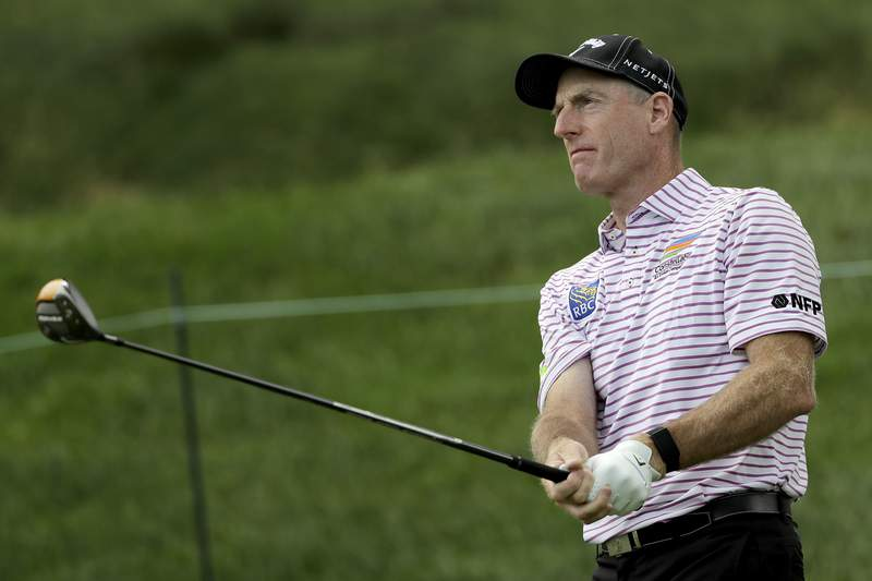 Jim Furyk watches his tee shot on the 17th hole during the first round of the Travelers Championship golf tournament at TPC River Highlands, Thursday, June 25, 2020, in Cromwell, Conn. (AP Photo/Frank Franklin II)