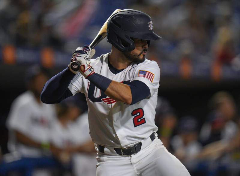 A detailed view of the Olympic rings logo on the butt end of that bat used by Eddy Alvarez #2 of the United States while at bat against Venezuela in the sixth inning during the WBSC Baseball Americas Qualifier Super Round at Clover Park on June 05, 2021 in Port St. Lucie, Florida. (Photo by Mark Brown/Getty Images)