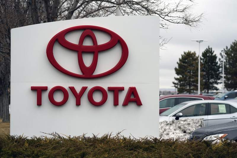 FILE - In this Sunday, March 21, 2021 file photo, The company logo adorns a sign outside a Toyota dealership in Lakewood, Colo. Toyota has reversed itself and says its political action committee will no longer contribute to legislators who voted against certifying Joe Bidens presidential election win. The move comes after a social media backlash over the contributions, with threats to stop buying Toyota vehicles. (AP Photo/David Zalubowski, File)