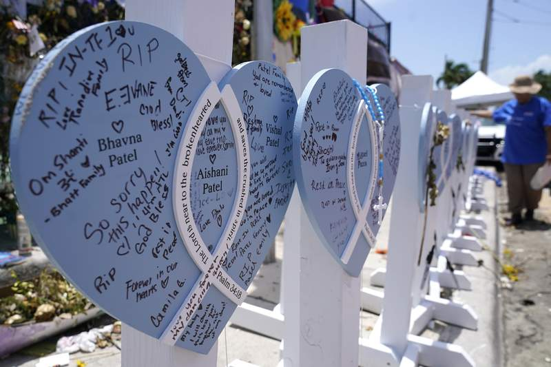 A wooden heart at a makeshift memorial remembers the family of Vishal and Bhavna Patel, who died along with their 1-year-old daughter Aishani, in the collapse of the nearby Champlain Towers South building in Surfside.