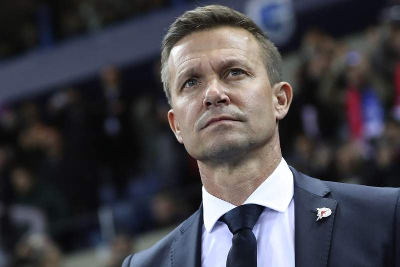 FILE - In this file photo dated Wednesday, Nov. 27, 2019, Salzburg soccer coach Jesse Marsch stands on the sidelines during a Champions League group E soccer match against Genk at the KRC Genk Arena in Genk, Belgium. American coach Jesse Marsch is taking over German soccer team Leipzig next season.   The Bundesliga club said Thursday that Marsch will switch from sister club Red Bull Salzburg on a two-year contract until June 2023.  (AP Photo/Francisco Seco, FILE)