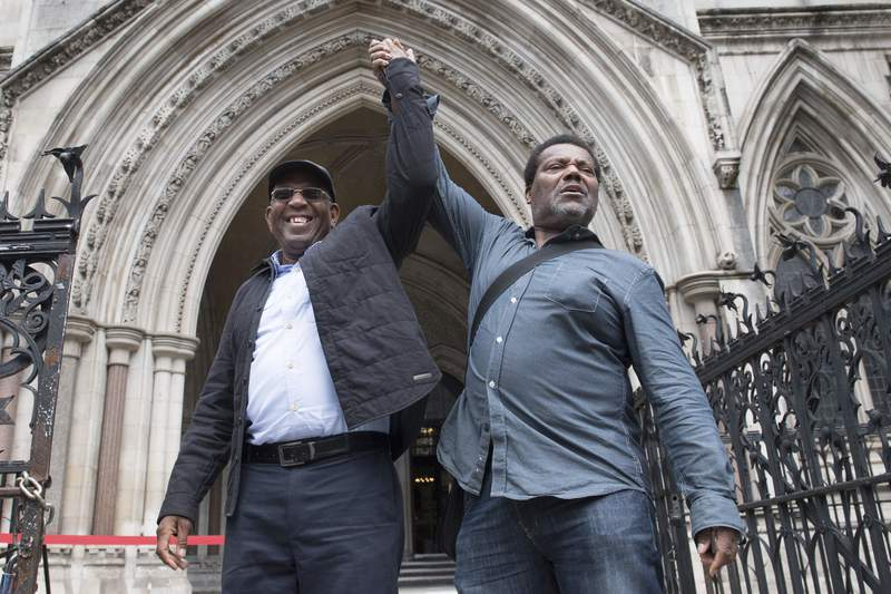 Paul Green, left, and Cleveland Davidson outside the Royal Courts of Justice in London, Tuesday July 6, 2021. Britains Court of Appeal has exonerated three Black men who were convicted of robbery nearly 50 years ago, the latest in a series of cases that have been overturned because they relied on the testimony of a corrupt police officer who later died in prison. The court on Monday quashed the convictions of Courtney Harriot, Paul Green and Cleveland Davidson, who were aged between 17 and 20 when they were accused of trying to rob a plainclothes detective on a London Underground train. (Stefan Rousseau/PA via AP)