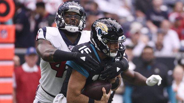 Jaguars quarterback Gardner Minshew is sacked by Whitney Mercilus in Sunday's loss to the Texans.