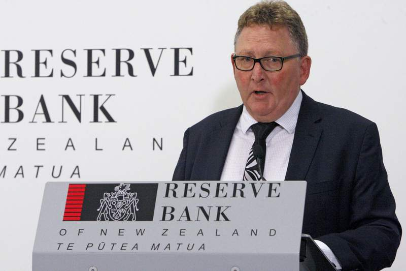 FILE - In this May 8, 2019, file photo, New Zealand's Reserve Bank Governor Adrian Orr speaks to the media in Wellington, New Zealand. New Zealand's central bank on Monday, March 16, 2020 cut the benchmark interest rate to a record low 0.25%. The cut of 0.75% came outside of the bank's normal schedule for changing rates. The Reserve Bank of New Zealand said in a statement that the negative impact of the pandemic on the New Zealand economy will be significant. For most people, the new coronavirus causes only mild or moderate symptoms. For some, it can cause more severe illness, especially in older adults and people with existing health problems.  (AP Photo Nick Perry, File)