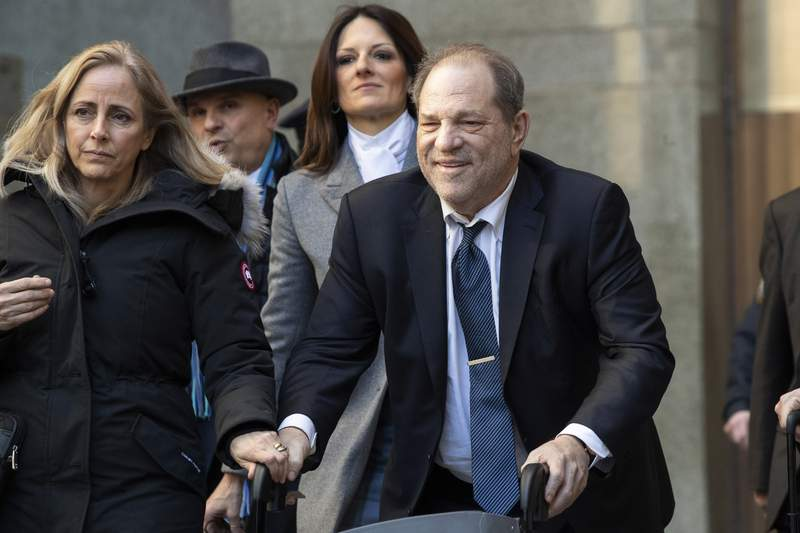"""FILE - In this Feb. 21, 2020, file photo, Harvey Weinstein leaves the courthouse during jury deliberations in his rape trial in New York. With Weinstein facing sentencing this week, his lawyers argued Monday, March 9, that the disgraced movie mogul deserves mercy in his New York City rape case because he's already suffered a """"historic"""" fall from grace and is dealing with serious health issues. (AP Photo/Mary Altaffer, File)"""