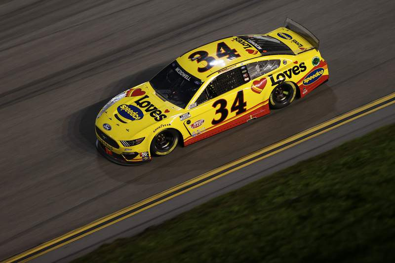 DAYTONA BEACH, FLORIDA - FEBRUARY 14: Michael McDowell, driver of the #34 Love's Travel Stops Ford, drives during the NASCAR Cup Series 63rd Annual Daytona 500 at Daytona International Speedway on February 14, 2021 in Daytona Beach, Florida. (Photo by James Gilbert/Getty Images)