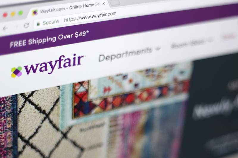 FILE - This April 17, 2018, file photo shows the Wayfair website on a computer in New York. Self-proclaimed internet sleuths are matching up names of Wayfair's products to those of missing children as part of a baseless conspiracy theory that claims the retail giant is using storage cabinets to traffic children. Wayfair responded: There is, of course, no truth to these claims. (AP Photo/Jenny Kane, File)