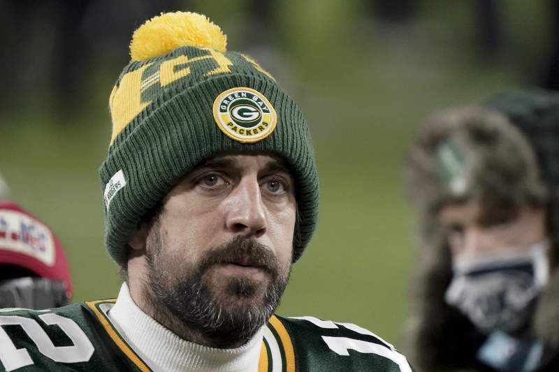 FILE - In this Sunday, Jan. 24, 2021, file photo, Green Bay Packers quarterback Aaron Rodgers (12) walks off the field after the NFC championship NFL football game against the Tampa Bay Buccaneers in Green Bay, Wis.  In a news conference, Monday, July 5, 2021, reigning NFL MVP Rodgers said he has spent this offseason focusing on improving himself in every respect, and that goes beyond making sure hes in top physical shape. (AP Photo/Morry Gash, File)