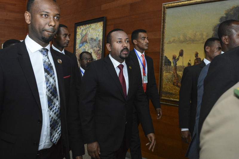 """FILE - In this Sunday, Feb. 9, 2020, file photo, Ethiopia's Prime Minister Abiy Ahmed, center, arrives for the opening session of the 33rd African Union (AU) Summit at the AU headquarters in Addis Ababa, Ethiopia. Ethiopia's prime minister on Wednesday, Nov. 4, 2020 ordered the military to confront the Tigray regional government after he said it attacked a military base overnight, citing months of """"provocation and incitement"""" and declaring that """"the last red line has been crossed."""" (AP Photo, File)"""