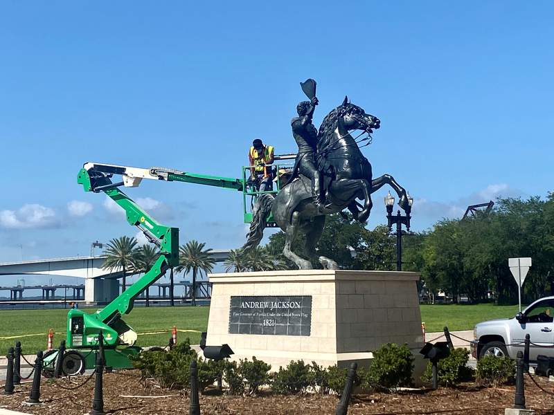 Picture shows crews restoring Andrew Jackson statue on Independent Drive, near where the Jacksonville Landing used to be.