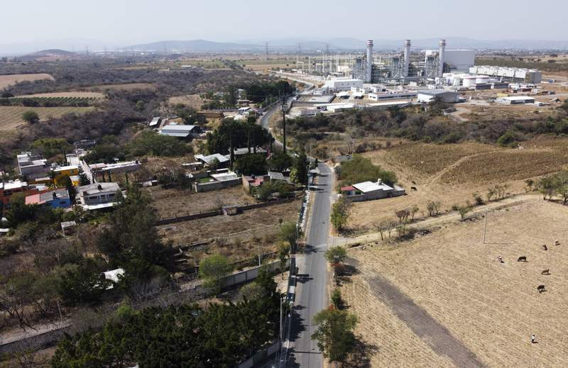 FILE - In this Feb. 22, 2020 file photo, a power generation plant stands idle near Huexca, Morelos state, Mexico. A constitutional reform presented by President Andrs Manuel Lpez Obrador would cancel contracts under which some private power generating plants plants sell power into the national grid, declares illegal other private plants that sell energy direct to corporate clients in Mexico and would cancel many long-term energy supply contracts and clean-energy preferential buying schemes. (AP Photo/Eduardo Verdugo, File)