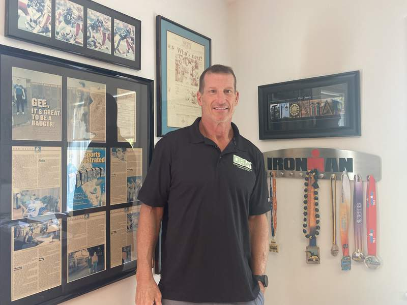 Former Jaguars defensive tackle Don Davey stands in his office at Disciplined Equity Management. Davey, who has completed 10 Ironman triathlons, is part of an eight-rider team that will race 3,000 miles across America later this month.