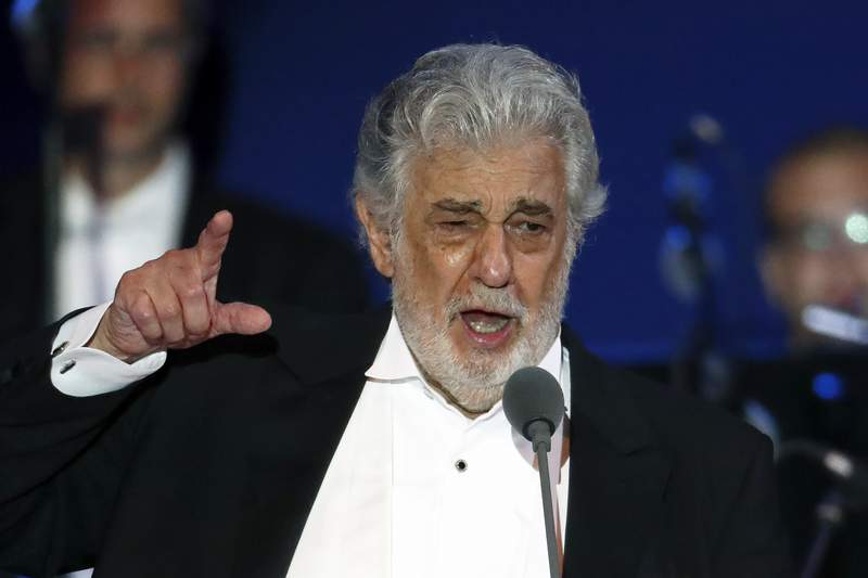 FILE - In this Aug. 28, 2019, file photo, opera singer Placido Domingo performs during a concert in Szeged, Hungary. A senior member of the main U.S. union that represents opera performers resigned Monday, March 2, 2020, accusing the leadership of a cover-up in its investigation into accusations of sexual harassment against superstar Plcido Domingo. Samuel Schultz, a baritone and elected officer of the American Guild of Musical Artists, had provided the full findings of the union's investigation to The Associated Press, which he said AGMA's leadership had planned to keep secret as part of an agreement with Domingo.(AP Photo/Laszlo Balogh, File)