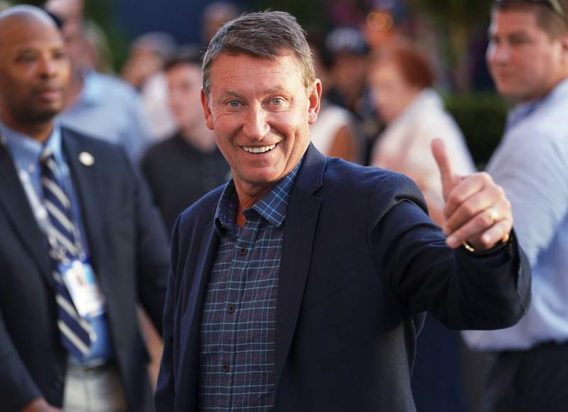 FILE - In this Sept. 4, 2019, file photo, Wayne Gretzky attends the quarterfinals of the U.S. Open tennis tournament in New York. Turner Sports has reached a multi-year agreement with Gretzky to be a studio analyst when its coverage of the National Hockey League begins in October. He will appear during key moments in the regular season  including opening week and the Winter Classic  and then throughout the Stanley Cup Playoffs. (Photo by Greg Allen/Invision/AP, File)
