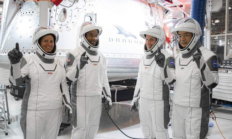 NASA's SpaceX Crew-1 astronauts from left are mission specialist Shannon Walker, pilot Victor Glover, and Crew Dragon commander Michael Hopkins, and mission specialist Soichi Noguchi, Japan Aerospace Exploration Agency (JAXA) astronaut.