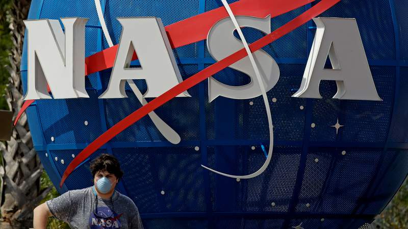 A boy poses for a photo at the Kennedy Space Center Visitor Complex at Cape Canaveral.