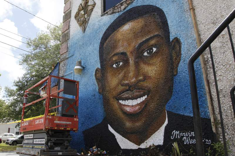 A mural of Ahmaud Arbery is on display in Brunswick, near where the 25-year-old man was shot and killed in February. It was painted by Miami artist Marvin Weeks.