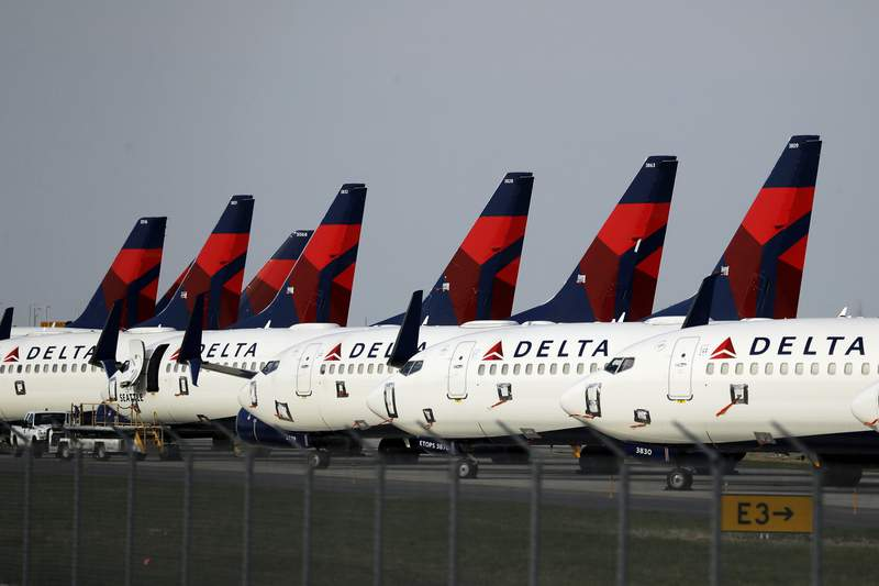 FILE - In this April 1, 2020, file photo, several dozen Delta Air Lines jets are parked at Kansas City International Airport in Kansas City, Mo. A U.S. Labor Department judge says the head of the Federal Aviation Administration helped Delta Air Lines retaliate against a pilot who raised safety concerns while he was an executive with the airline. (AP Photo/Charlie Riedel, File)
