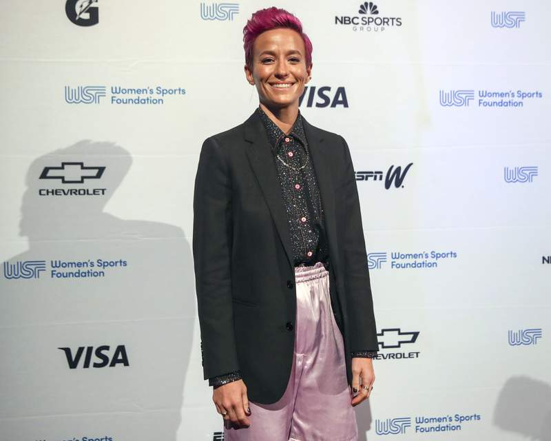 FILE - Soccer player Megan Rapinoe poses for photos on the red carpet of the Women's Sports Foundation's 40th annual Salute to Women in Sports in New York on Oct. 16, 2019. Rapinoe has selected #MeToo founder Tarana Burke's memoir, Unbound, for her new book club. (AP Photo/Mary Altaffer, File)