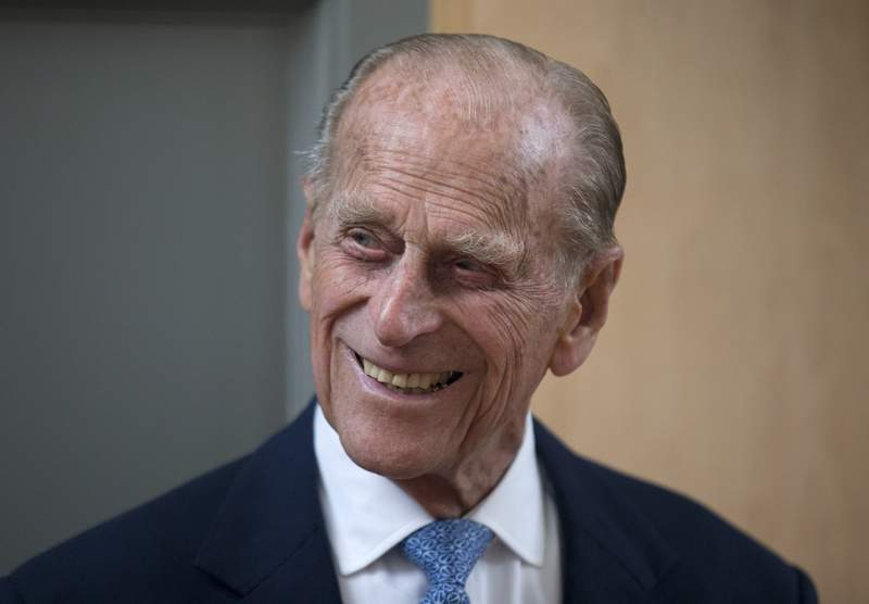 FILE - In this June 8, 2015 file photo, Britain's Prince Philip, the husband of Queen Elizabeth II, smiles after unveiling a plaque at the end of his visit to Richmond Adult Community College in Richmond, south west London. A judge ruled Thursday Sept. 16, 2021, that the will of the late Prince Philip should remain secret to protect the dignity of his widow Queen Elizabeth II, who is Britains head of state. (AP Photo/Matt Dunham, File)