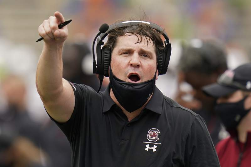 FILE - South Carolina head coach Will Muschamp has words with an official during the first half of an NCAA college football game against Florida, Saturday, Oct. 3, 2020, in Gainesville, Fla. (AP Photo/John Raoux, Pool)