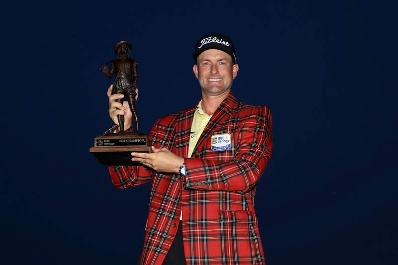 HILTON HEAD ISLAND, SOUTH CAROLINA - JUNE 21: Webb Simpson of the United States celebrates with the trophy and the plaid jacket after winning during the final round of the RBC Heritage on June 21, 2020 at Harbour Town Golf Links in Hilton Head Island, South Carolina. (Photo by Streeter Lecka/Getty Images)