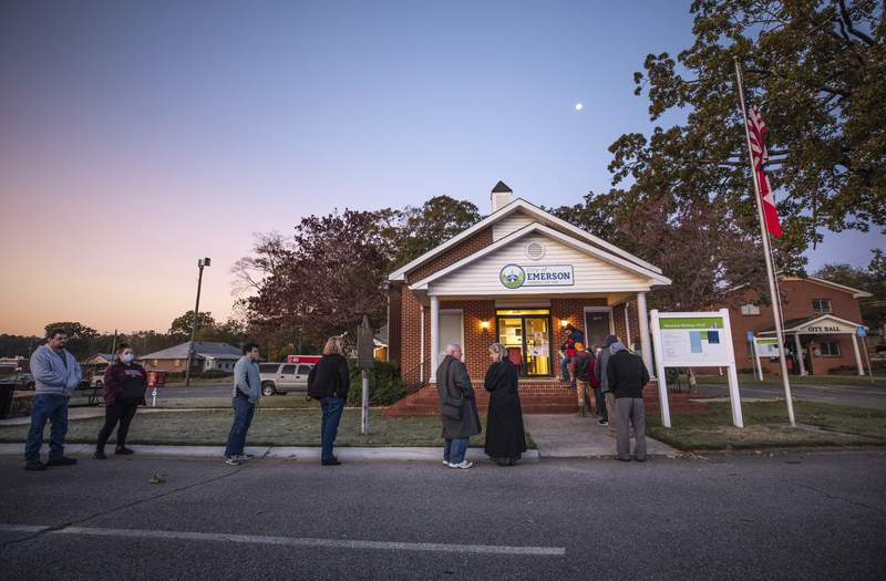 Voters line up to cast their ballots on Election Day, Tuesday, Nov. 3, 2020, in Emerson, Ga. (AP Photo/Branden Camp)