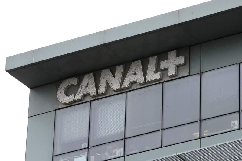 """In this photo taken on Feb. 6, 2019 the headquarters of French TV Canal Plus, is pictured in Boulogne-Billancourt, outside Paris. Powerful French entertainment company Canal Plus trademarked the term """"Planet"""" in France, but environmental groups are pushing back, saying they should be allowed to use the word """"planet"""" to promote their projects to save it. Multiple cases are under examination by France's intellectual property regulator INPI, including one coming to a head this week. (AP Photo/Christophe Ena)"""