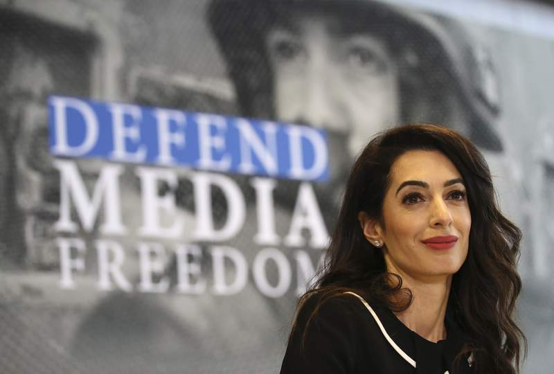 FILE - In this Friday, April 5, 2019 file photo, International human rights lawyer Amal Clooney smiles during a Foreign Ministers G7 meeting in Dinard, Brittany. Clooney has become the highest profile lawyer to quit over her opposition to the British governments suggestion that it could break international law in the event it fails to agree a trade deal with the European Union. In a letter Friday, Sept. 18, 2020 to British Foreign Secretary Dominic Raab, the human rights lawyer said she is quitting her role as the U.K.s special envoy on media freedom over the governments lamentable suggestion. (AP Photo/David Vincent, file)