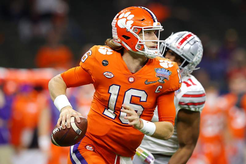 Trevor Lawrence of the Clemson Tigers looks to pass in the third quarter against the Ohio State Buckeyes during the College Football Playoff semifinal game at the Allstate Sugar Bowl at Mercedes-Benz Superdome on January 01, 2021 in New Orleans, Louisiana. (Photo by Kevin C. Cox/Getty Images)