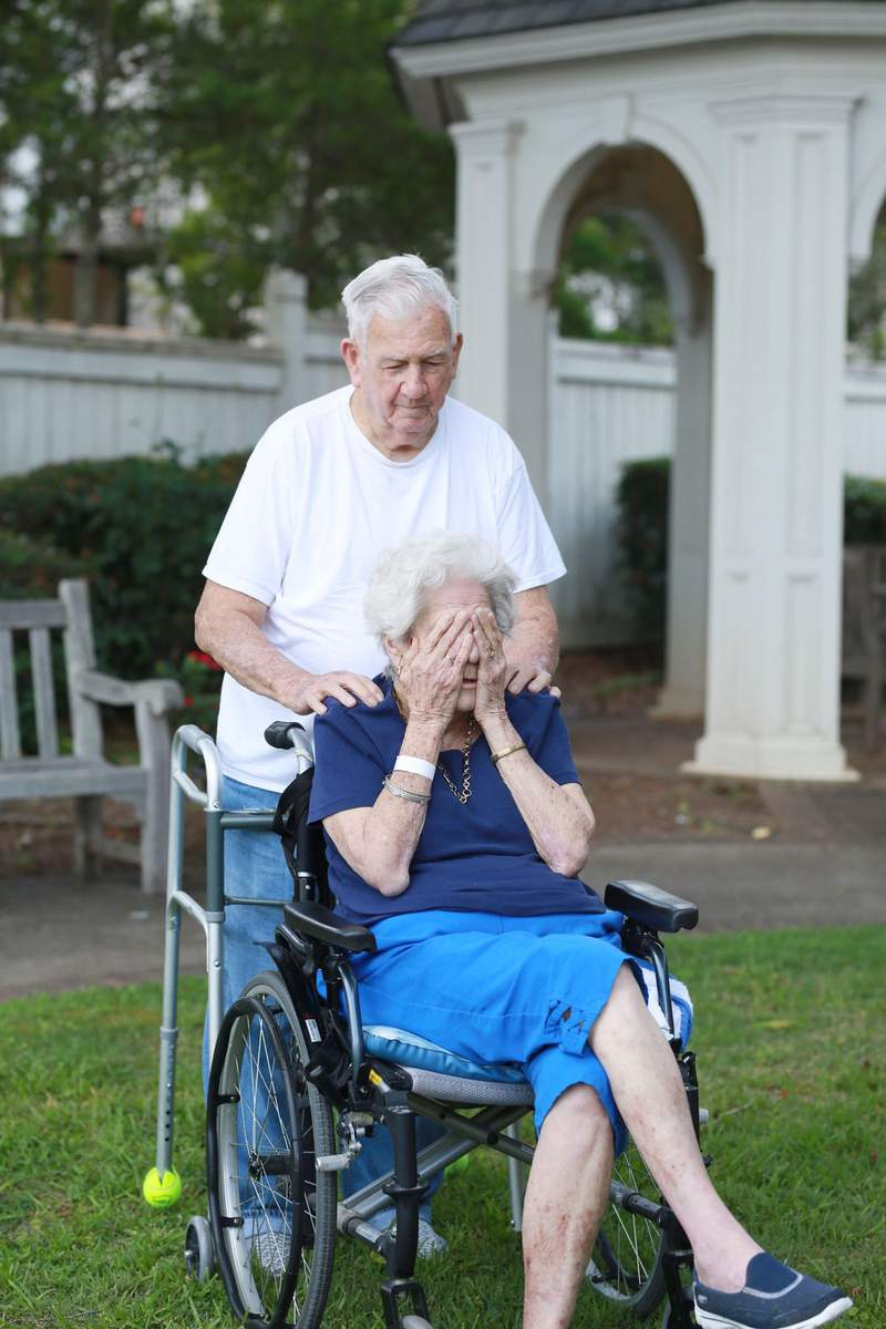 A man surprises his wife after being separated for three months due to COVID-19.