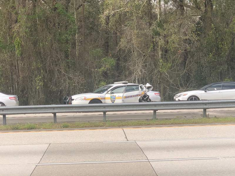 A damaged police cruiser could be seen Sunday on I-95 near Philips Highway.