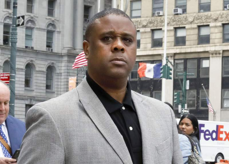FILE - Former amateur basketball league director Merl Code, leaves federal court in New York on Oct. 4, 2019 after sentencing for his role in a college basketball bribery scheme that focused on NBA-bound athletes. Hanover Square Press announced Tuesday that Codes Black Market will be published in March 2022. Hanover is calling the book an explosive insider account of the dark underworld of college basketball.(AP Photo/Richard Drew, File)