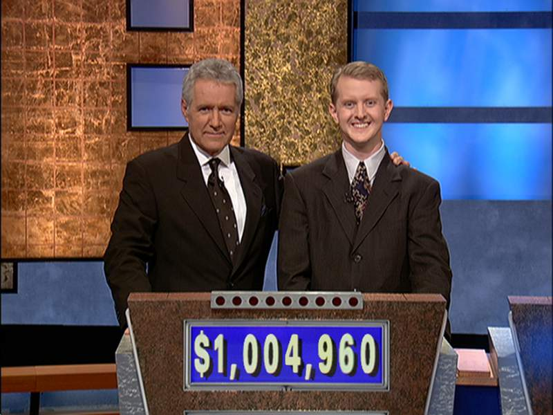 Jeopardy host Alex Trebek, (L) poses contestant Ken Jennings after his earnings from his record breaking streak on the gameshow surpassed 1 million dollars July 14, 2004 in Culver City, California.  (Photo by Jeopardy Productions via Getty Images)