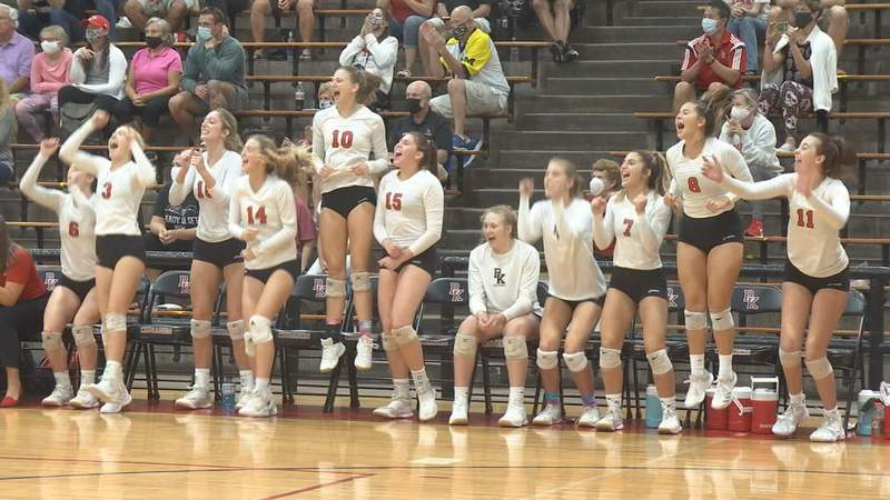 Members of the Bishop Kenny volleyball team cheer on during Saturday's Region 1-4A final against Santa Fe.