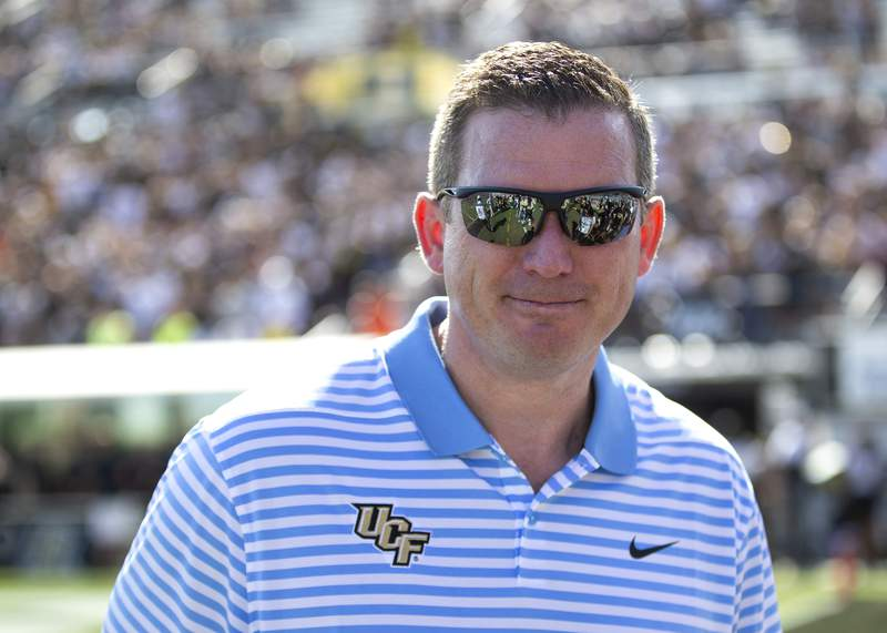 FILE - In this Nov. 2, 2019, file photo, Central Florida athletic director Danny White stands on the sideline at the team's NCAA college football game against Houston in Orlando, Fla. White has signed a five-year contract that will pay him more than $1 million annually. (AP Photo/Willie J. Allen Jr., File)