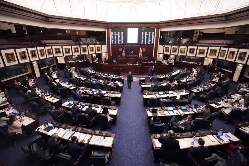 Florida representatives work through a legislative session, Wednesday, April 28, 2021, at the Capitol in Tallahassee, Fla. (AP Photo/Wilfredo Lee)