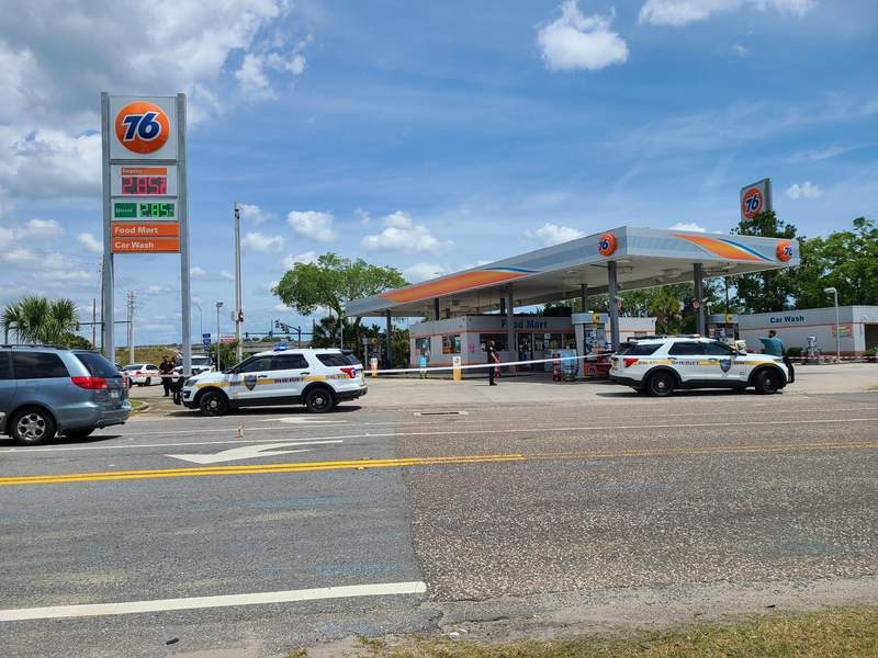 Police investigate a shooting Sunday in Normandy.