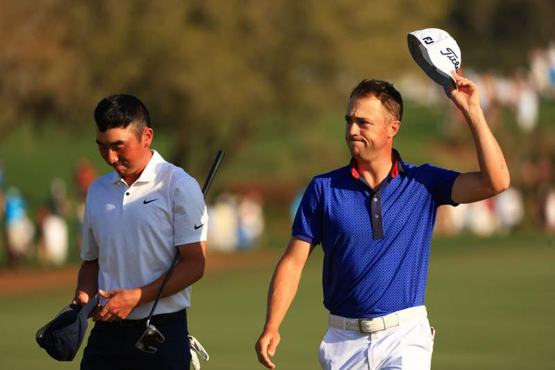 Justin Thomas of the United States celebrates with Doug Ghim after finishing on his way to winning on the 18th green during the final round of The Players Championship at TPC Sawgrass on March 14, 2021 in Ponte Vedra Beach, Florida. (Photo by Mike Ehrmann/Getty Images)