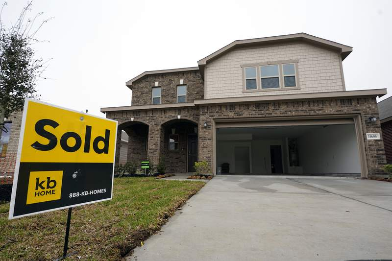 FILE - In this March 15, 2021 file photo, a sold sign stands in front of new home under construction in Houston. Mortgage rates remained near historic lows this week, Thursday, June 10. The benchmark 30-year home loan remained below the 3% mark amid continued positive indications of the economy's recovery from the pandemic recession. (AP Photo/David J. Phillip, File)