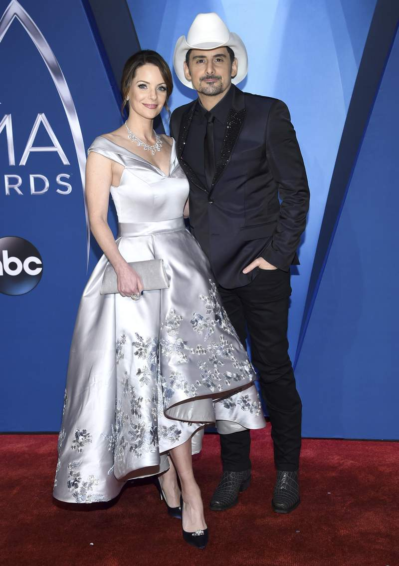Kimberly Williams-Paisley, left, and Brad Paisley arrive at the 51st annual CMA Awards on Wednesday, Nov. 8, 2017, in Nashville, Tenn. The couple have pledged to donate one million nutritional meals in various cities around the country. The initiative is billed as the Million Meal Donation Tour, which kicked off in Detroit last week. The tour will run for two weeks visiting food banks in 16 major cities.(Photo by Evan Agostini/Invision/AP)