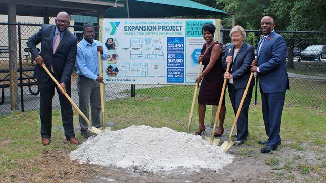 (From left to right) Dr. Irvin Cohen, executive director of the Johnson Family Y & VP of Social Responsibility; Quiwanaki Ramsey, Teen Program graduate; Wanda Jones, chair of the Johnson Family YMCA Advisory Board; Peggy Bryan, Chair, Metropolitan Board of Directors; and Eric K. Mann, President and CEO, YMCA of Florida's First Coast.